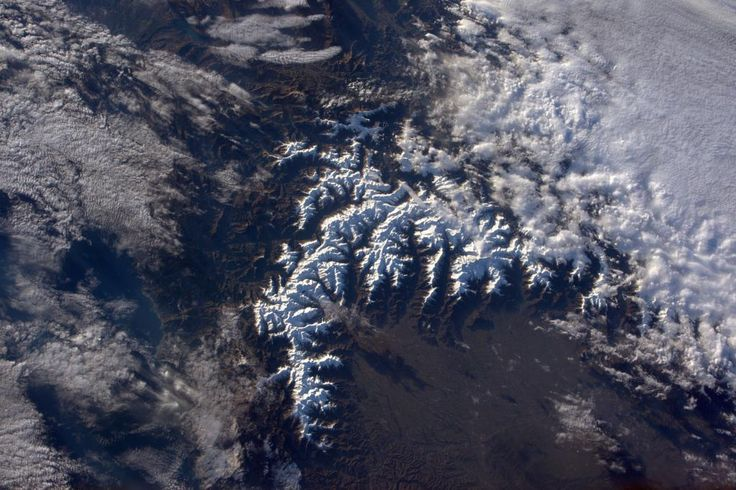 Snow-capped Western Alps. Amazing how that little cloud can cast such a big shadow on the Po plane in #Italy!