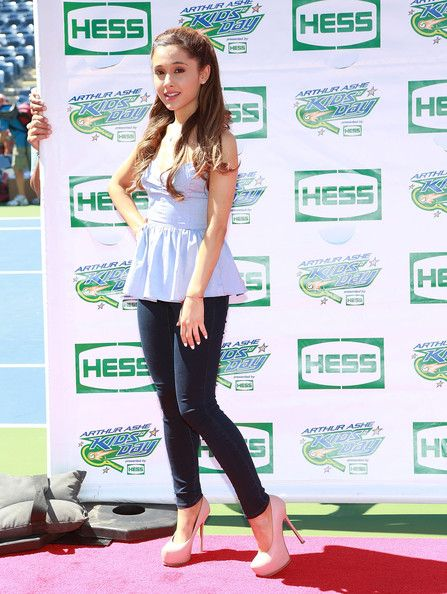Ariana Grande look at the hands on the board in the backround