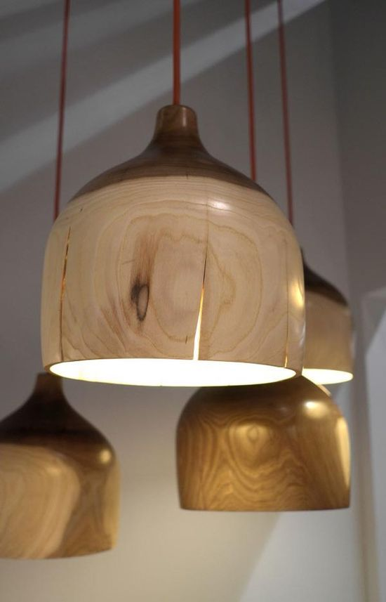 """The Crack Bowl Light by Korean design artist Kwon Jae Min, who created a unique pendant light made from thin sheets of locally-sourced wood. He thinks that """"Object is the metaphor of that time."""" Fissures that run along the pendant light give it an exotic apperance and accentuates the expert wood craftsmanship.."""