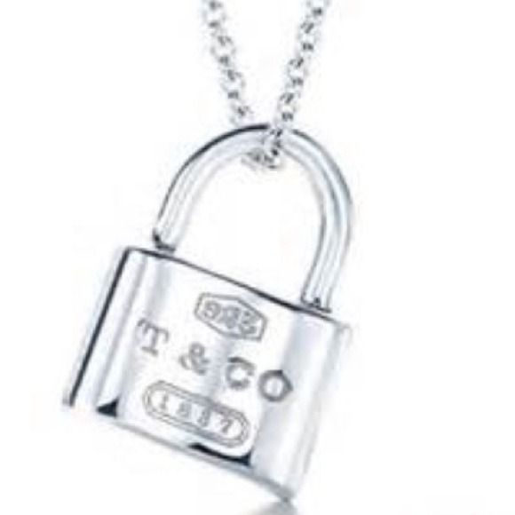 Tiffany padlock necklace charm gorgeous Excellent condition padlock necklace opens and closes perfectly  (charm only) .925 silver comes with pouch...exquisite! Tiffany & Co. Jewelry Necklaces