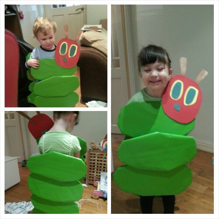 The very hungry caterpillar world book day costume. Using cardboard, wrapping paper and coloured card for the face. Using string to put it over the shoulders.