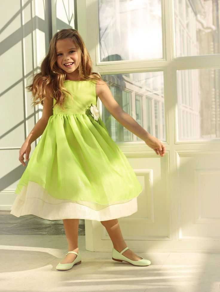 Short sleeved silk organza dress by La stupenderia in their spring summer 2013 collection, with a bow at the waist and a golden linen under skirt. #green #lastupenderia #SS13 #spring #summer #springsummer2013 #children #kids #childrenwear #kidswear #girls