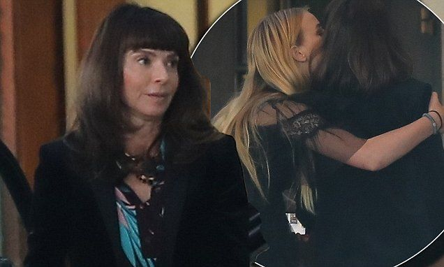 Ewan McGregor's wife Eve Mavrakis gets a hug from daughter Esther