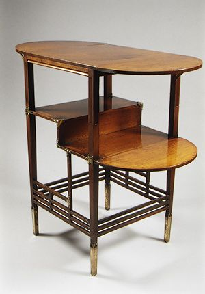 * Side table, 1871 Edward William Godwin (British, 1833–1886) Walnut and brass, The table demonstrates the ideals characteristic of the Aesthetic movement in Britain from the 1860s to 1880s. The overall composition of the table, with its attenuated lines and asymmetrical organization of stretchers and posts, creates a rhythm of horizontal and vertical elements that echo Asian as well as traditional English influences