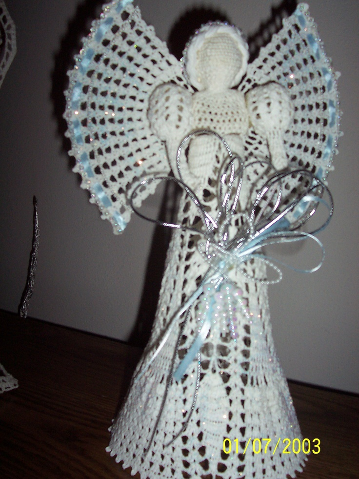 Hand crocheted angel. Various patterns. Approx 12 inches tall. Starched to retain shape. Decorated in various colors.