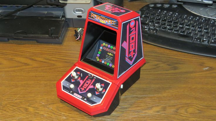 Number 2.  This one has a different colour scheme plus 1 and 2 player buttons on the control panel.