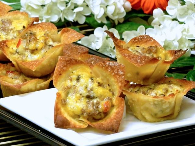 Cheesy Sausage Stars Appetizer Recipe: Crispy baked wonton cups are filled with a cheesy sausage, onion, and garlic mixture. These little gems make a great finger food appetizer for parties or any other special occasion, especially Super Bowl.