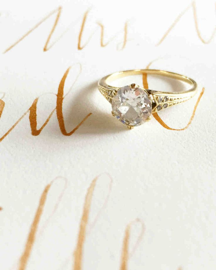 A DIY Wedding, With a Ceremony in a Pool | Martha Stewart Weddings - Jessie's engagement ring, designed by New York City jeweler Catherine Angiel, and photographed atop one of the envelopes Jessie calligraphed in gold ink.