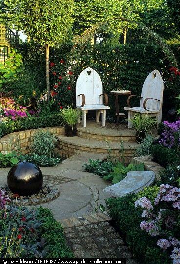 love the brick hardscape design in this small garden