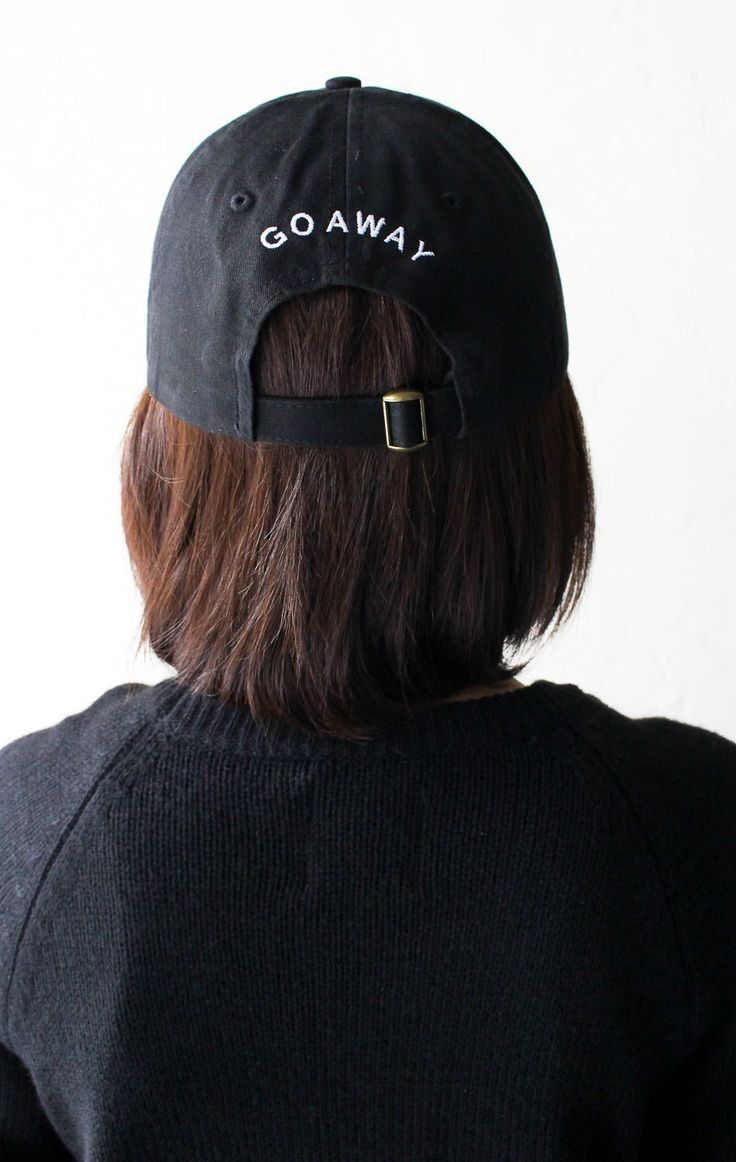 - Description Details: Black six panel baseball cap with 'Go Away' embroidery on the back & adjustable back with tri-glide buckle. 100% Chino Twill. Imported. All accessories are final sale. Sizing: O