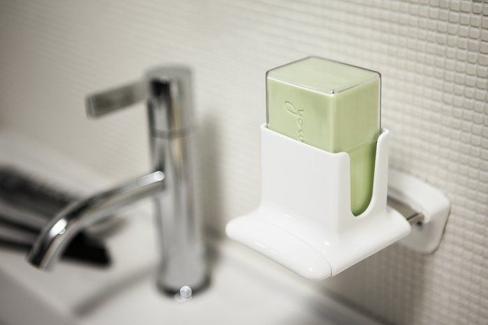 SOAP FLAKES – A NEW RITUAL  With every gentle push of the sliding unit, tender flakes of soap fall right into your hands from the soap dispenser, making the act of washing your hands a new kind of experience.