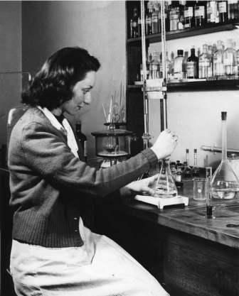 "Love this photo of a ""lady scientist' at work in 1951."