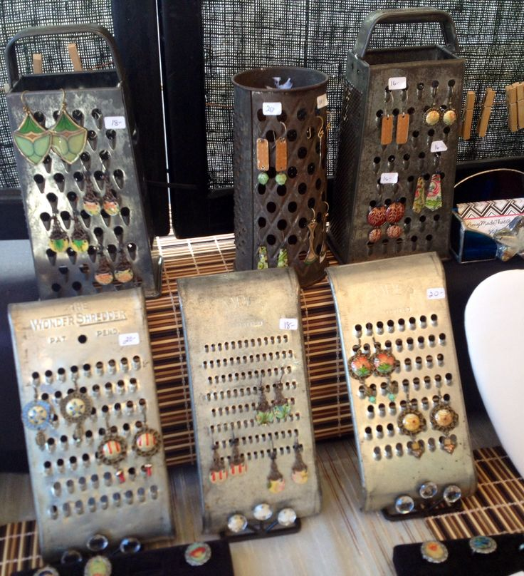 Cute (though somewhat bulky) way to display earrings ... on an antique cheese grater! #diy #organization #jewelry