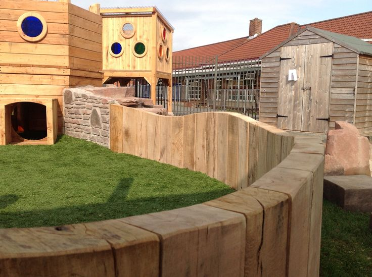 This lovely chunky retaining wall snakes its way across the playground and creates mini rooms and smaller spaces.