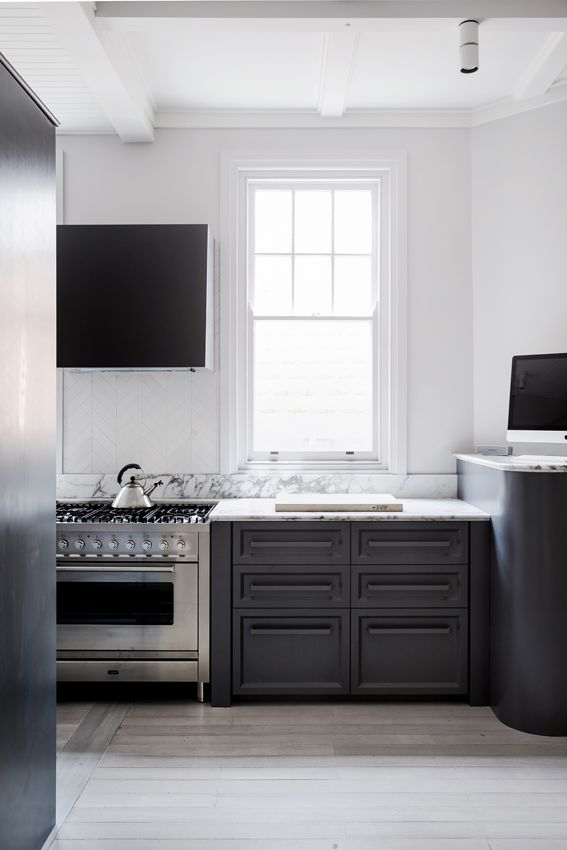 Art Deco Apartment Potts Point. Kitchen detail showing navy blue joinery, colour matched handles and arabescato marble bench top.