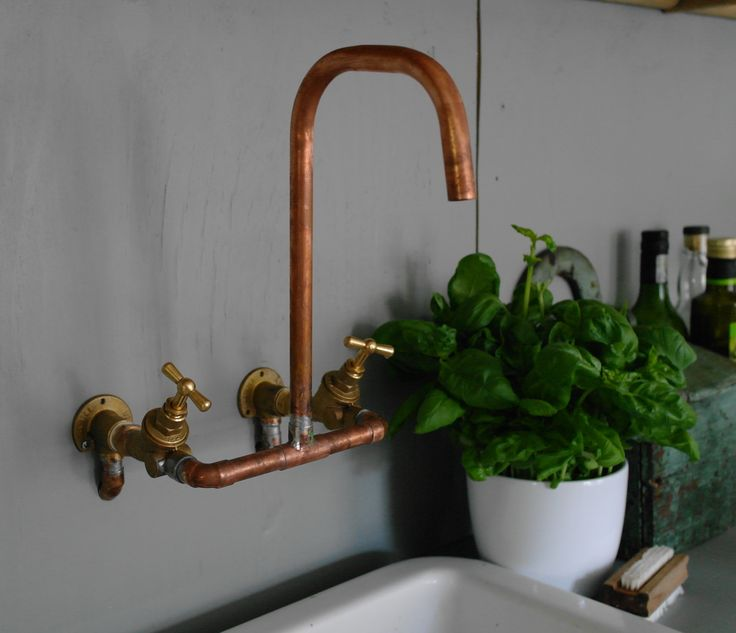 copper faucet - above Belfast sink standing on brick base.