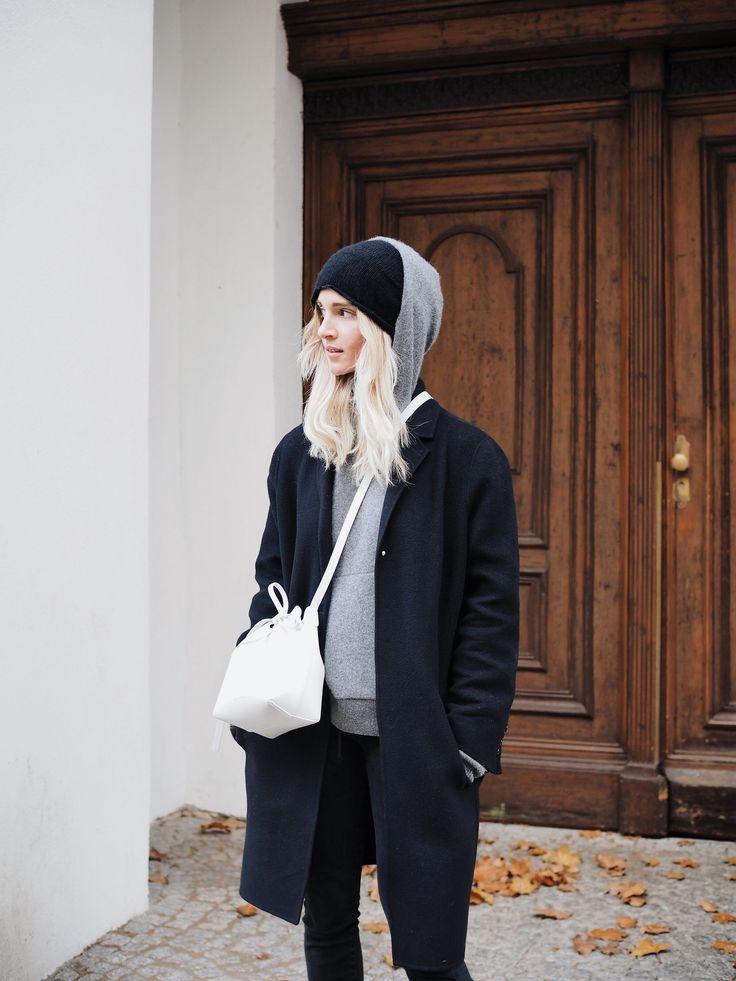 Cos beanie, The Kooples coat, Acne Studios cashmere hoodie, Mansur Gavriel bucket bag. Via Mija