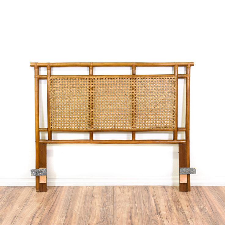This headboard is featured in a natural rattan with a honey finish. This bohemian style bed panel has a caned panel and sturdy legs. Perfect for adding tropical vibes! #bohemian #beds #headboard #sandiegovintage #vintagefurniture