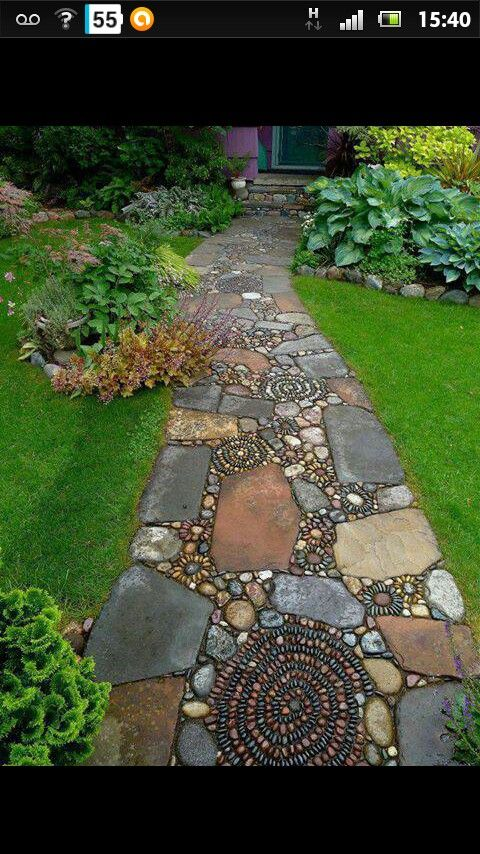 LOVE the artistic laying of stones for a patio. This has such great texture and movement to it. Also seems like it would be fun to create.