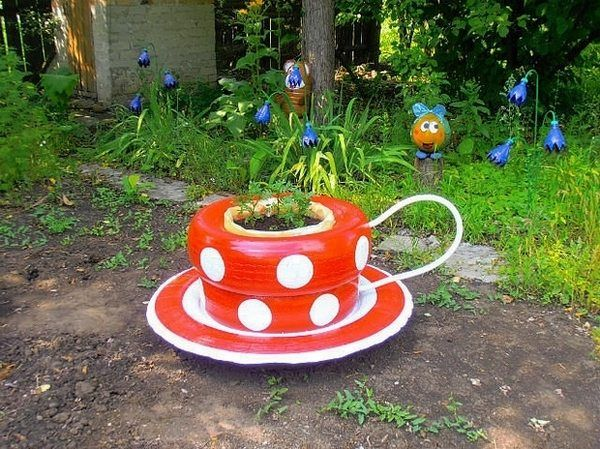 recycle car tires DIY garden decor ideas coffee cup flower bed