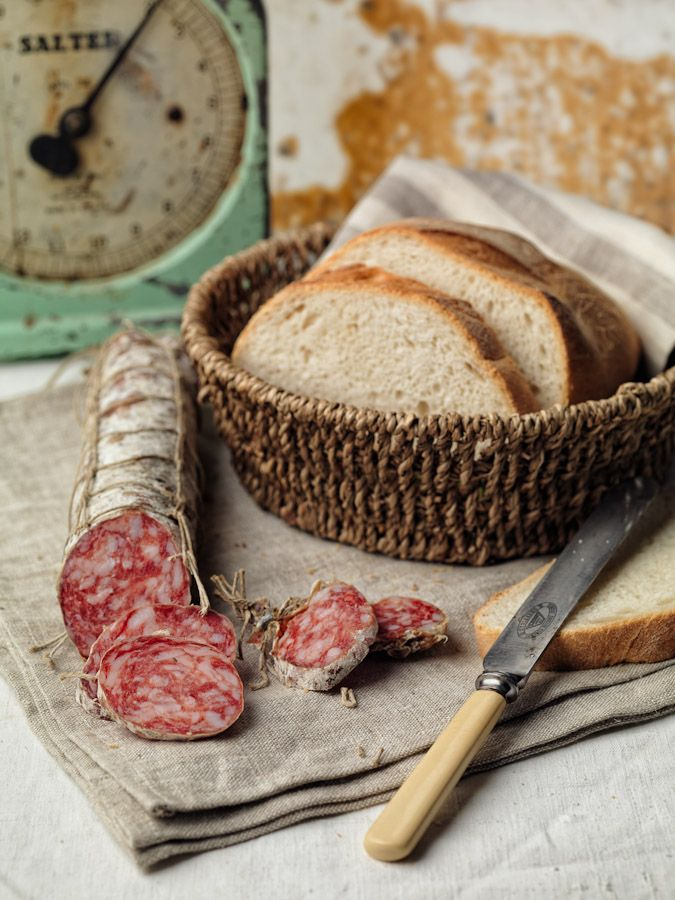 Salame Piacentino :: coarse-minced salami, placed between two slices of bread, with a glass of wine