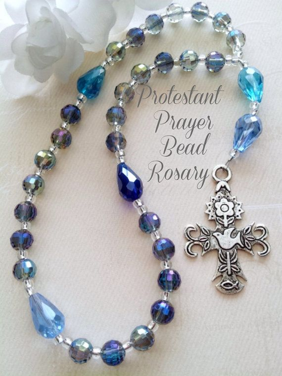Anglican Prayer Beads, Protestant Prayer Beads, Christian Prayer Beads, Blue Teardrop Beads, Episcopal Prayer Beads, Holy Spirit Cross  Beautiful Anglican Protestant Rosary Prayer Beads in Multiple Colors of Blue AB Crystals with detailed Pewter Dove Cross  The weeks beads which consist of four sets of seven, consist of 8 mm round faceted AB beads in a beautiful deep blue color. The AB coating reflects the light casting off beautiful colors. The 4 Cruciform beads and the Inviatory Bead are…