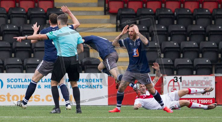 Referee Greg Aitken points to the spot during the Ladbrokes League One game between Airdrieonians and Queen's Park.