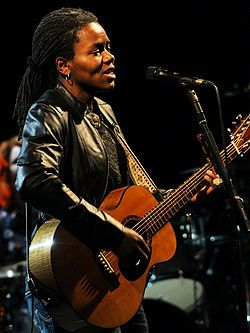 "Tracy Chapman (born March 30, 1964) is an American singer-songwriter, known for her singles ""Fast Car"", ""Talkin' 'bout a Revolution"", ""Baby Can I Hold You"", ""Crossroads"", ""Give Me One Reason"" and ""Telling Stories"". She is a multi-platinum and four-time Grammy Award-winning artist."