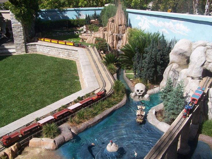 OMG!!!  This guy created a miniature Disneyland in his backyard.  Unbelievable.