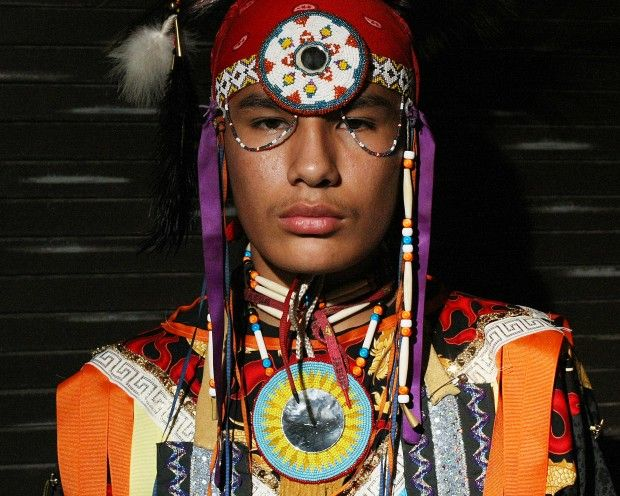 Phill Wright, 15, of Lower Brule, stands in the back hallway before participating in the 5th Grand Entry at the 24th Annual Black Hills Pow Wow at the Rushmore Civic Center in Rapid City on Sunday, October 10, 2010. Wright, a grass dancer, came to the Black Hills Pow Wow for the first time to support his father, Kevin, who is competing in the singing contest. (Aaron Rosenblatt/Journal staff)