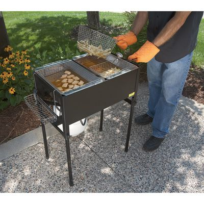 This Kitchener Triple Basket Deep Fryer is perfect for cooking fish, chicken, fries, onion rings, cheese curds and more! Great for home, picnics, parties and tailgating. Features a large 5.4-gallon cooking oil capacity. Heat comes from two high-pressure cast iron LP gas burners that produce up to 40,000 BTU.