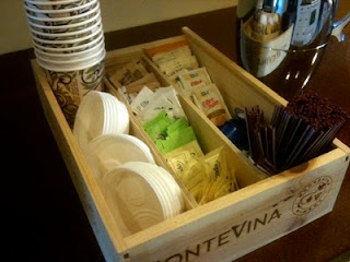Repurposed wine box hot beverage caddy.