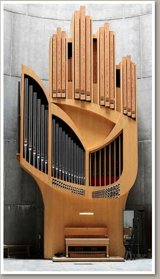 'The Hand of God' organ at Notre Dame des Neiges church in L'Alpe d'Huez, France.  The organ was built by German organbuilder Detlef Kleuker in 1978.  The very original organ case was designed by the church's architect, Jean Marol.   - photo from pleasuresofthepipes