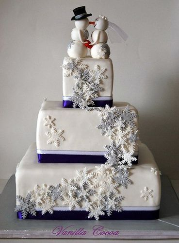 Snowflake wedding cake. Love the topper!! :)