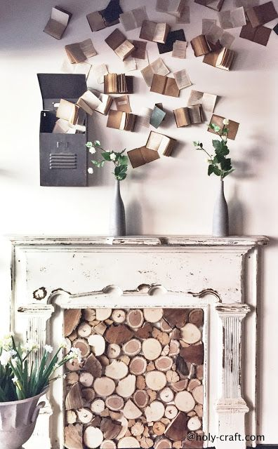Magnolia Market staged fireplace with logs and books.  I love how the books look like butterflies.
