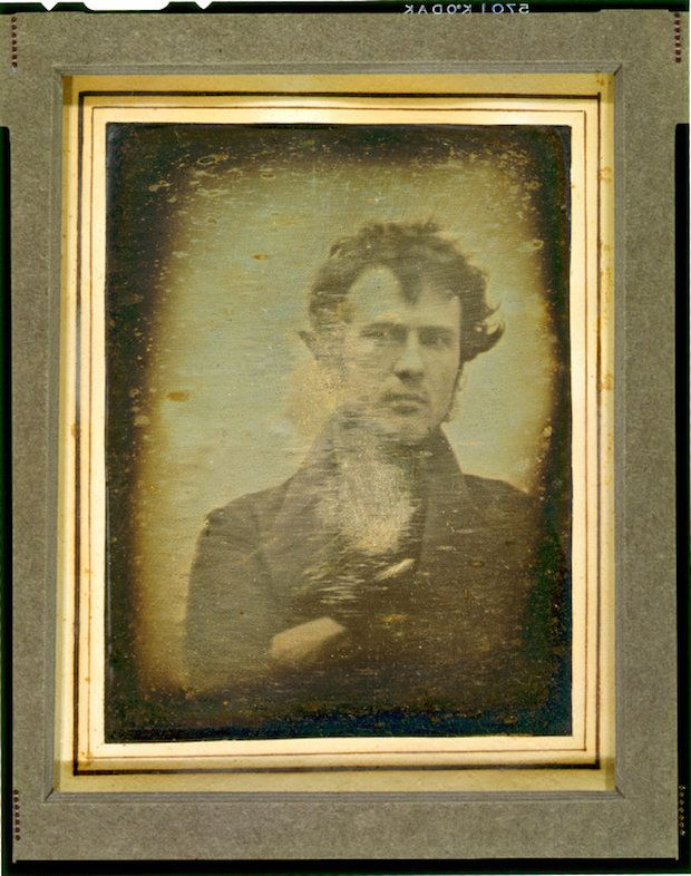 Robert Cornelius - Self Portrait (1839)  Possibly the first self-portrait, taken outside to ensure adequate light it would of required a few minutes of staying perfectly still for enough exposure.  Also detailed at http://www.loc.gov/pictures/item/2004664436/
