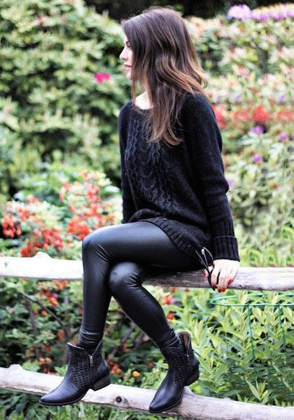 Sitting model in black faux leather skinny pants