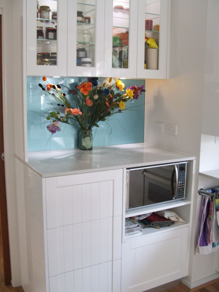Stowing the microwave saves precious bench space in this Custom Flatpack designed Colonial Shaker kitchen.  www.customflatpack.com.au
