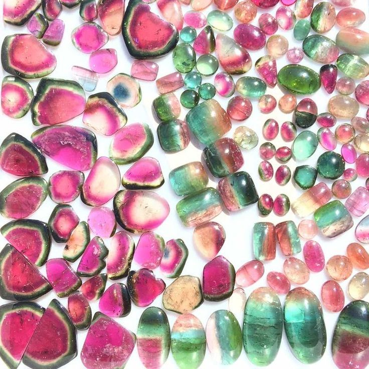 A tray of juicy watermelon tourmaline slices and cabochons. Discover the juiciest of pink and green summer gemstones that won't melt in the heat or wilt in the cold. The watermelon tourmaline is taking the jewellery world by storm: http://www.thejewelleryeditor.com/jewellery/watermelon-tourmalines-origins-appearance-how-is-it-formed/ #jewelry