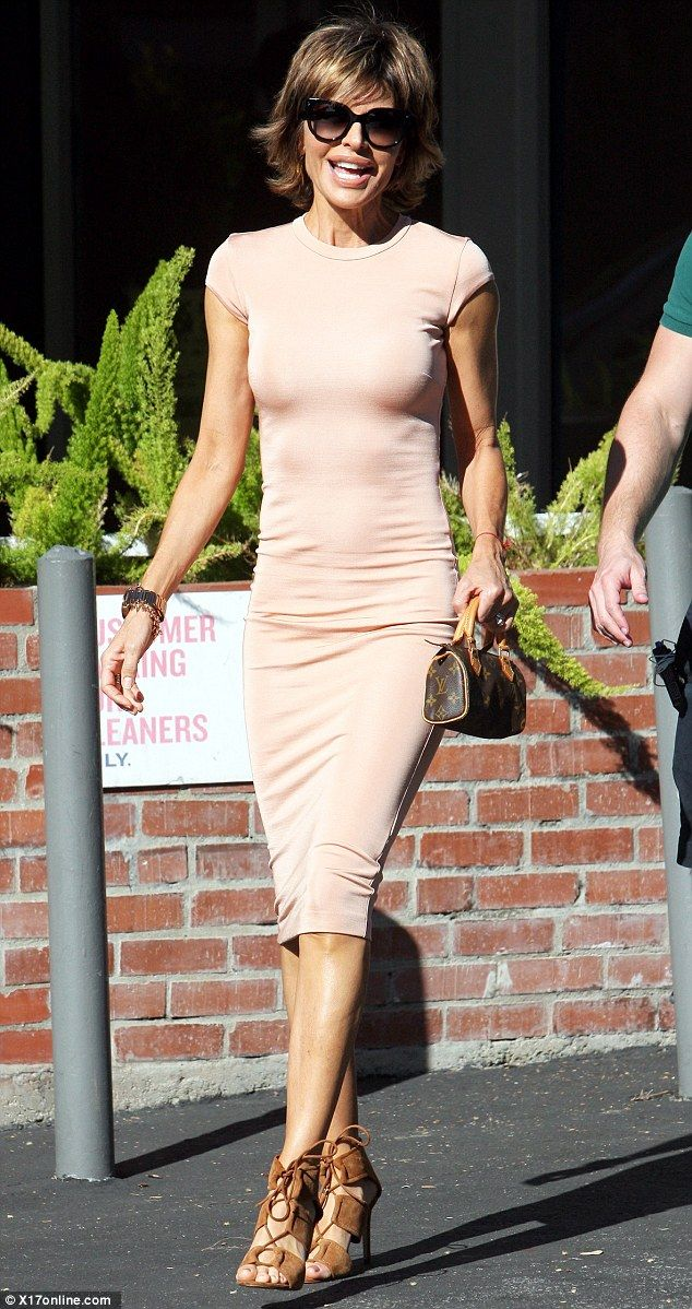 She's in the pink: Real Housewives Of Beverly Hills star Lisa Rinna showed off her enviably slender form in a figure-hugging blush-coloured dress on a shopping trip in her neighbourhood on Thursday