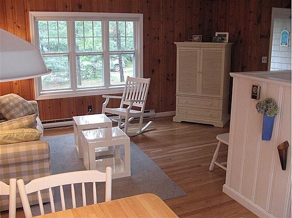 painting trim in knotty pine cabin | paintings