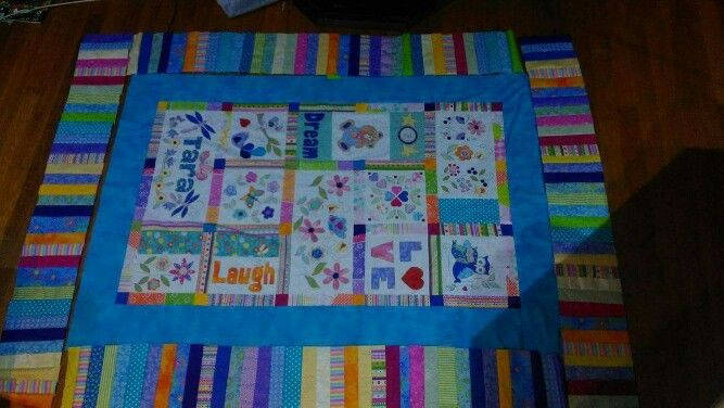 Almost finished!   Hand applique quilt for my god daughter:  Joy Ott designs