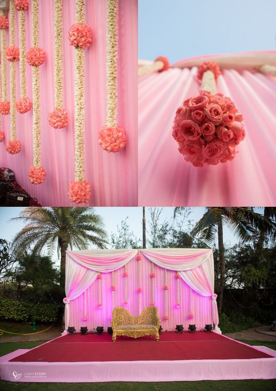 Love this pink themed stage décor with white and pink rose floral hangings and accent white and pastel drapery | Gold sofa set for bride and groom | Stage Décor Ideas | Indian Wedding Ideas | Credits: lightstory wedding photography | Every Indian bride's Fav. Wedding E-magazine to read. Here for any marriage advice you need |www.wittyvows.comshares things no one tells brides, covers real weddings, ideas, inspirations, design trends and the right vendors, candid photographers etc.