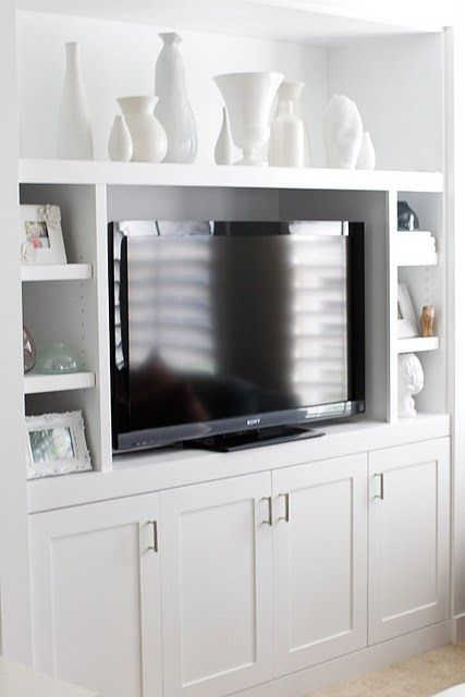 white built in for flat screen (Oh how I wish / hope we can do this to our landing! Would be better than the 2 shelf shelves we have holding up the TV and million books my kids have ~ Carrie)