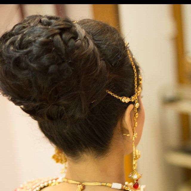 Such a trendy version of the classic chignon. A beautiful hair up for brides by my student Nupur. This was the bridal hair trend for 2015. #AHA will be unveiling it's bridal trend courses for 2016 shortly! Don't forget to sign up and expand your skill -o- meter! #redcarpethair #partyhair #bridalhair #fashionhair #avantgardehair #editorialhair