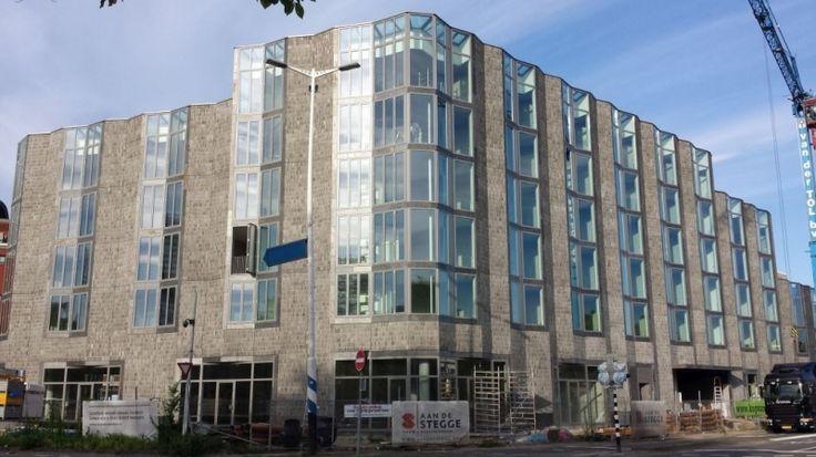 Appartementencomplex Kop van Lombok geïnspireerd op de Amsterdamse Stijl.
