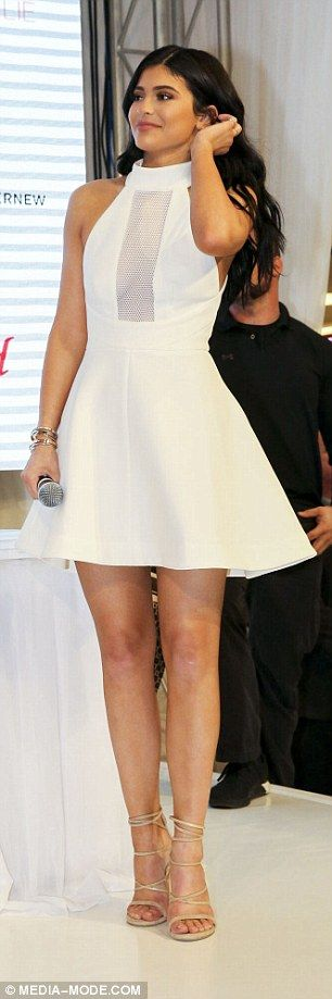 Cut out cutie: Kylie teamed the dress with a pair of nude strappy heels