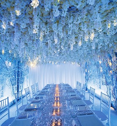 Event designer Preston Bailey created a winter wonderland with an almost-bare tabletop and a ceiling covered in hanging white blooms.