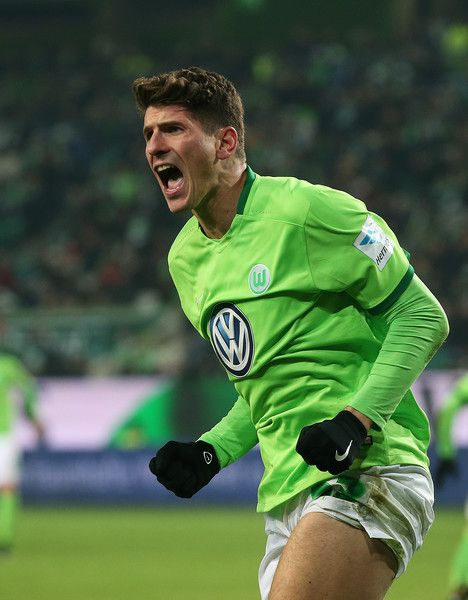 Mario Gomez of Wolfsburg reacts during the Bundesliga match between VfL Wolfsburg and Eintracht Frankfurt at Volkswagen Arena on December 17, 2016 in Wolfsburg, Germany.