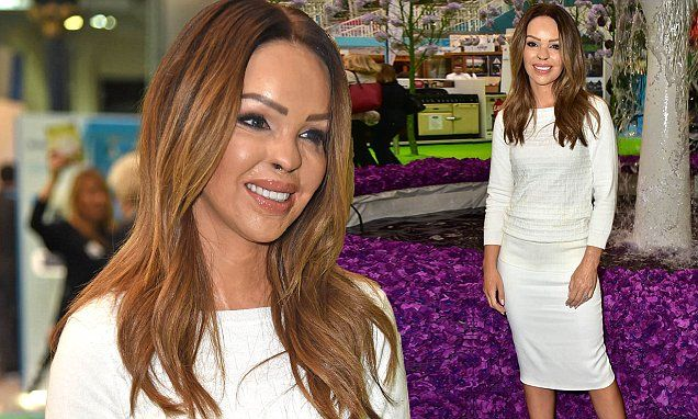 Katie Piper flaunts her toned curves in a figure-hugging pencil skirt